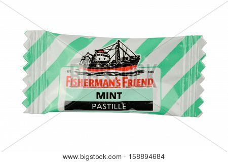 NETHERLANDS - DELFT - CIRCA FEBRUARY 2015: Fisherman's Friend peppermint candy produced by the Lofthouse company in Fleetwood Lancashire England.