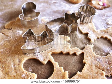 Christmas cookies or christmas baking with cookie dough and christmas ornaments. Cookie cutters.