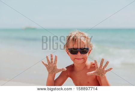 little boy having fun on sand tropical beach