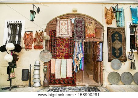 Souvenir shop in Icheri Sheher (Old Town) of Baku, Azerbaijan. Typical tourist shop with souvenirs and antiques.