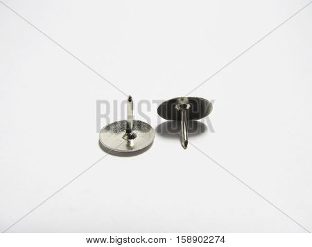 Drawing pins up and down isolated on white background