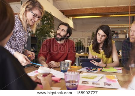 Female Manager Leads Brainstorming Meeting In Design Office