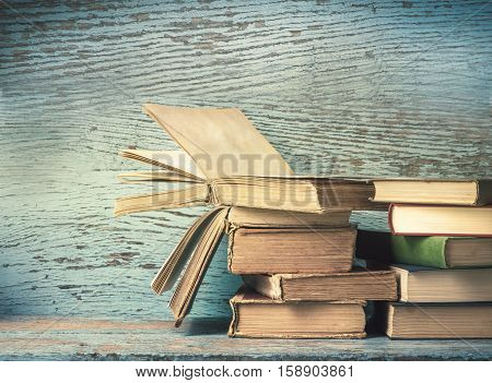 old books on a old wooden background