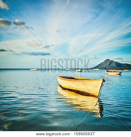 Fishing boat at sunset time. Mauritius