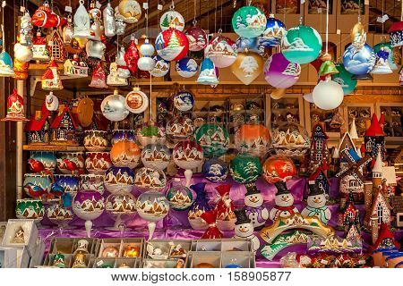 PRAGUE, CZECH REPUBLIC - DECEMBER 10, 2015: Wooden stall with decorations for winter holidays at traditional Christmas market taking place in december in Old Town of Prague.
