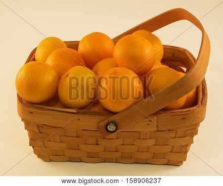 Organic Clementine (Mandarin) Oranges - Attractively arranged in a full woven basket.  Delcious, Sweet, and adds design and decor to any room.