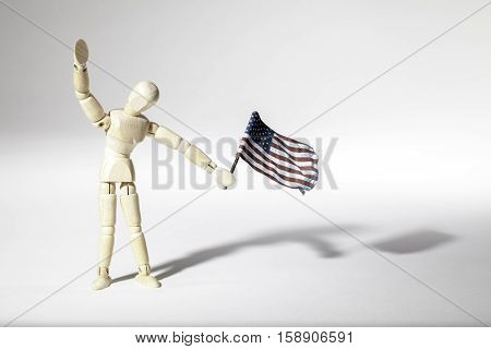 Annonymous average patriotic American represented by an faceless mannequin doll waving a USA flag. Connotations of citizenship and immigration.