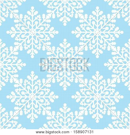 White snowflakes on blue background seamless pattern for continuous replicate