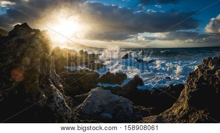 waves at the rocky shore of crete