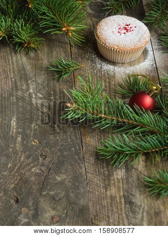 Homemade muffins for Christmas on the old wooden background. Christmas concept. Copy space composition. Soft focus