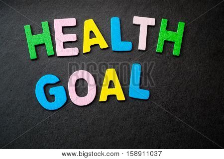 """Colorful wooden letters forming the phrase """"health goal"""""""