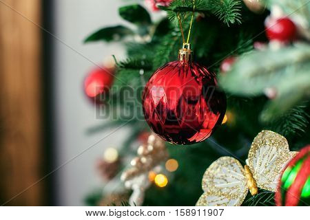 ball on the Christmas tree. The concept of Christmas and New Year