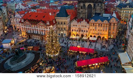 PRAGUE, CZECH REPUBLIC - DECEMBER 10, 2015: Panorama of Old Town Square with Christmas tree and traditional market in Prague - famous and popular place for visit with tourists during winter holidays.