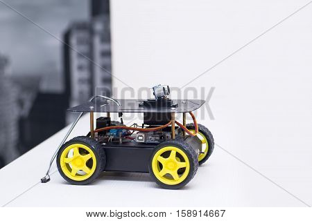 robot on the wheels with yellow wheels robot