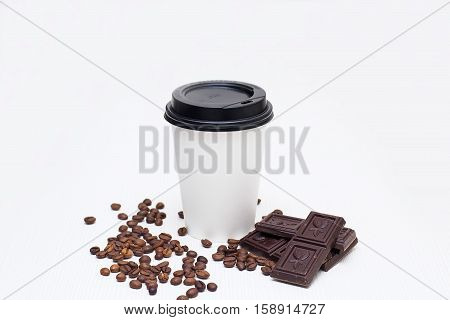 cup of coffee and chocolate chips with coffee beans