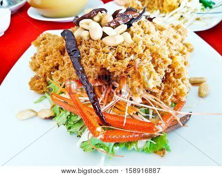 Closeup of Crispy shrimp salad with green mango