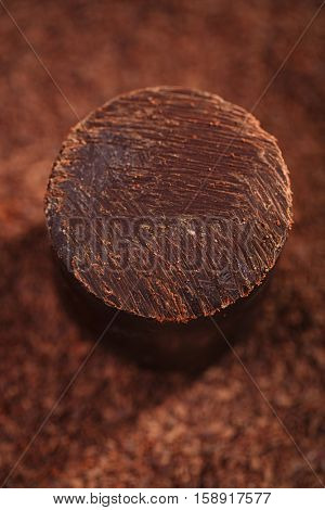 solid dark 100% chocolate on grated chocolate background