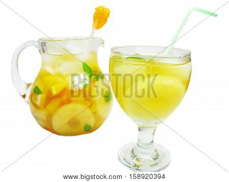 fruit juice cocktail punch in jug and glass with ice and fruit