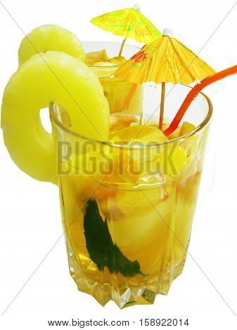 fruit cruchon cocktail punch in bowl with ice and fruit
