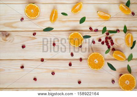scattered fruit on the table pomegranate and tangerine