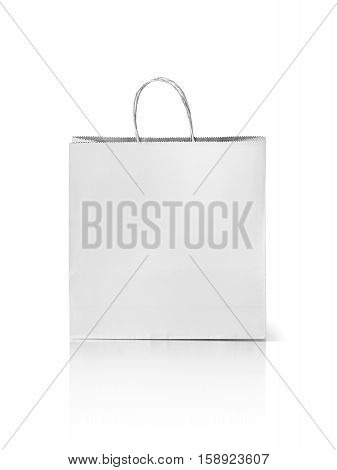 white recycled paper kraft shopping bag isolated on white background