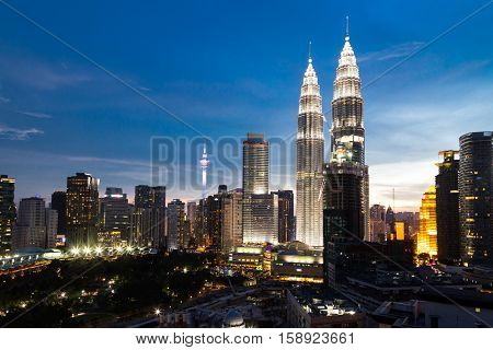 KUALA LUMPUR MALAYSIA - JULY 23 2016: View of the Twin Towers at KLCC City Center and KL Tower during dusk hour. The most popular tourist destination in Malaysian capital