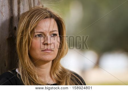 Portrait of a young thinking woman outdoor