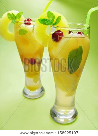 fruit cruchon cocktail punch in glasses with ice and fruit