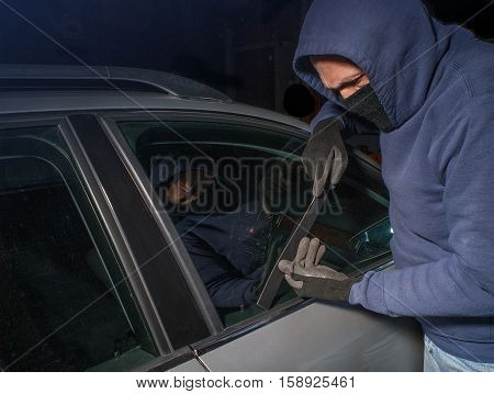 Car thief looking to break the lock