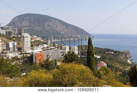 Panoramic view of the village Gurzuf and Bear Mountain (Au-Dag), Adalary Bolgatura the mountain. Crimea.
