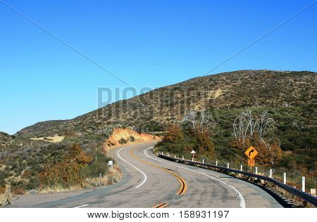 Twisting highway winding through the mountains, California