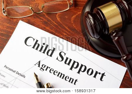 Child support agreement on an office table.