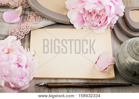 Empty Blank Paper on Retro Background with Peony Flowers and Vintage Lace and Pen