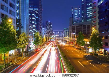 Cityscape of Shinjuku district with traffic lights on the street of Tokyo, Japan
