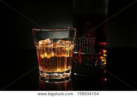 Glass of whisky on dark background