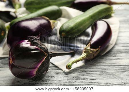 Fresh eggplants and zucchini on napkin, closeup