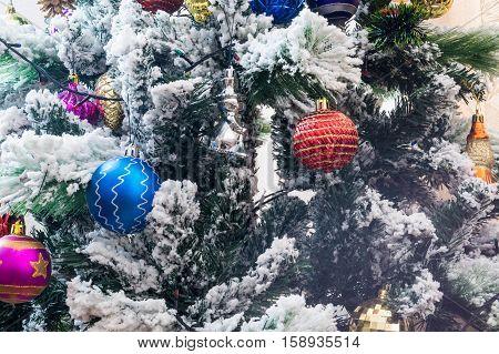 Christmas toys on the Christmas tree closeup