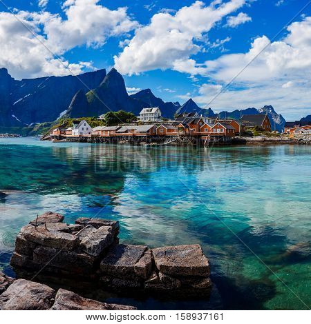 Lofoten is an archipelago in the county of Nordland, Norway. Is known for a distinctive scenery with dramatic mountains and peaks, open sea and sheltered bays, beaches and untouched lands. poster