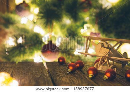 Christmas Tree With Presents And Handmade Wooden Airplane Toys