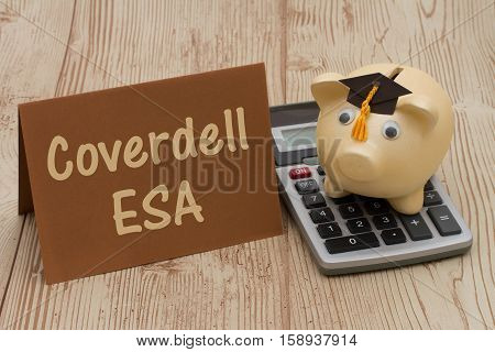 Your Coverdell education savings account A golden piggy bank with grad cap on a calculator on a desk with text Coverdell ESA