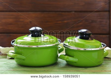 Cooking pot and ingredients for soup or stew on rustic background