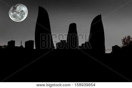 Silhouettes of Flame Towers skyscraper on sunset in Baku,  Azerbaijan.