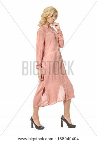 Portrait Of Flirtatious Woman In Pink Maxi Dress Isolated On White