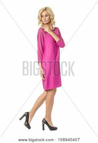 Portrait Of Flirtatious Woman In Pink Silk Dress Isolated On White
