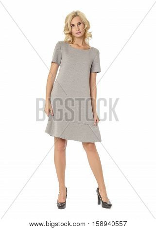 Portrait Of Flirtatious Woman In Gray Dress Isolated On White