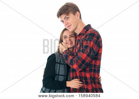 close up of  young stylish couple in love having fun in studio isolated on white background