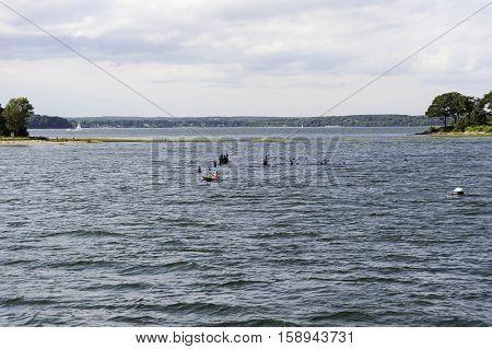 Portland Maine USA - August 9 2009: Kayaker paddling away from cut between Little Diamond Island and Great Diamond Island