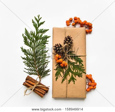 Gift Box In Craft Paper On White Background. Christmas Or Other Holiday Concept, Top View, Flat Lay