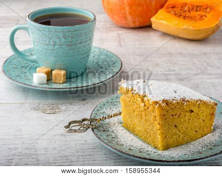 pumpkin pie, tea, pumpkin and pumpkin piece  on a white wooden table
