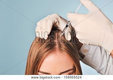 Woman Is Getting Injection In Head. Mesotherapy.